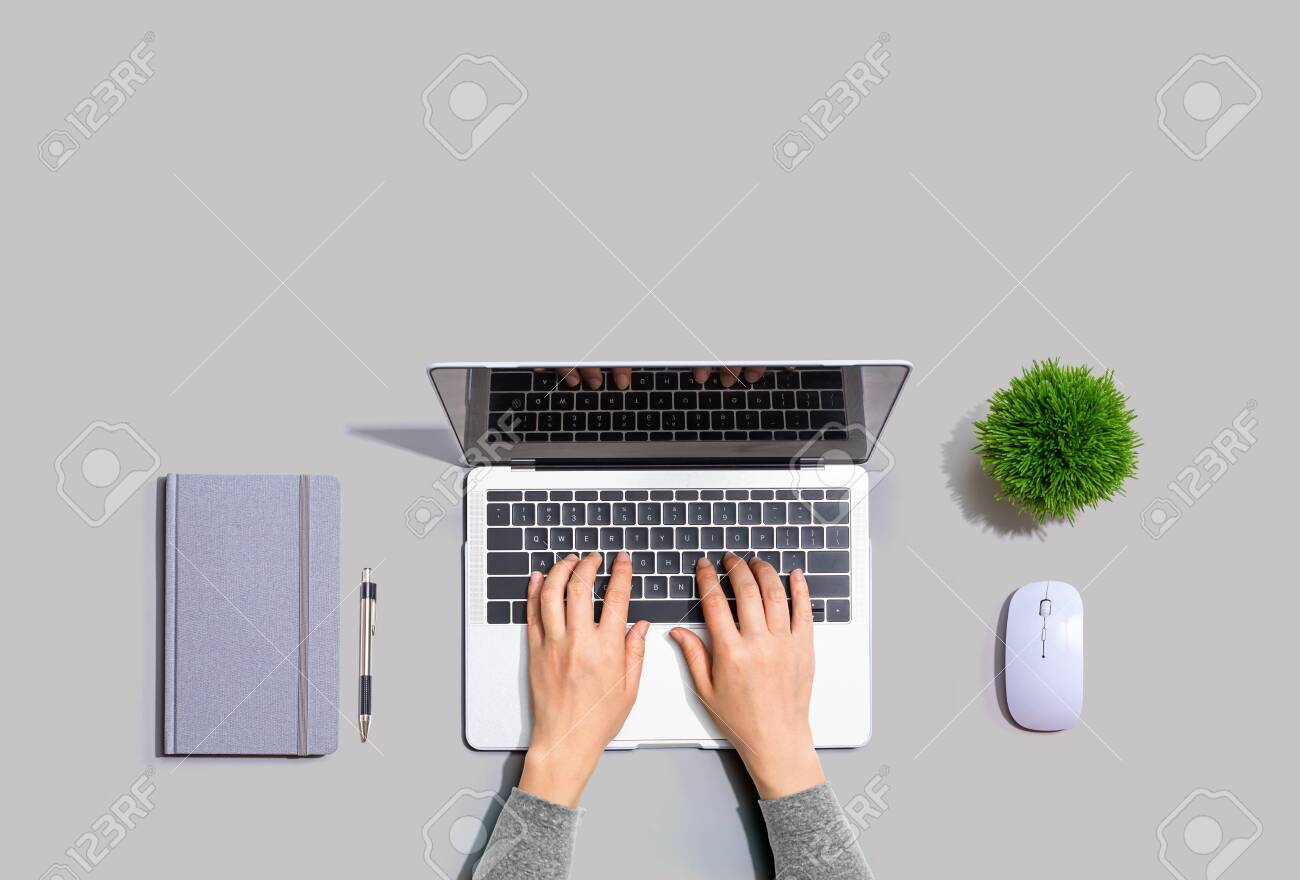 Person using a laptop computer from above - 132426539