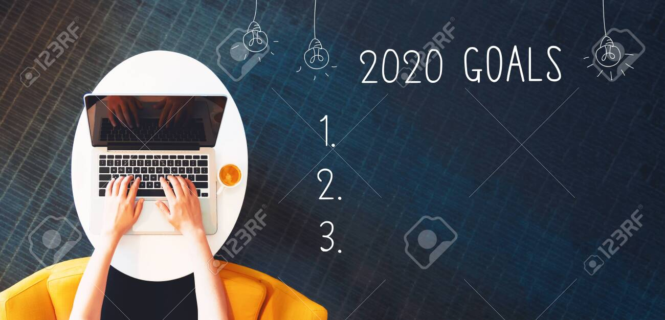2020 goals with person using a laptop on a white table - 132770024
