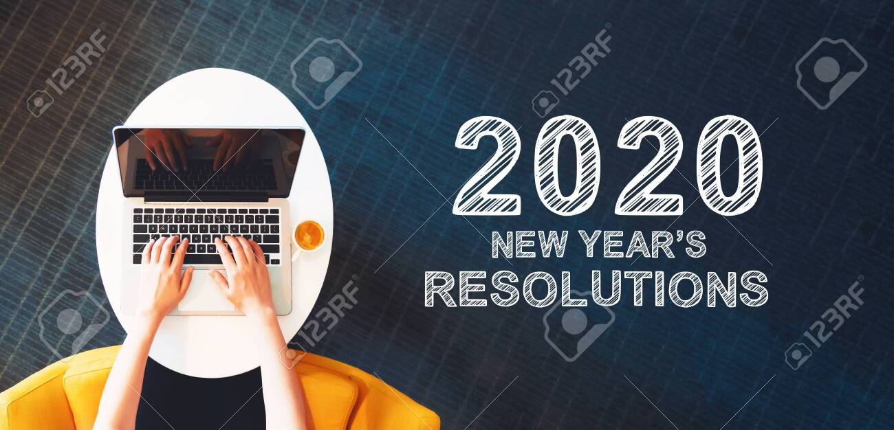 2020 New Years Resolutions with person using a laptop on a white table - 133175187