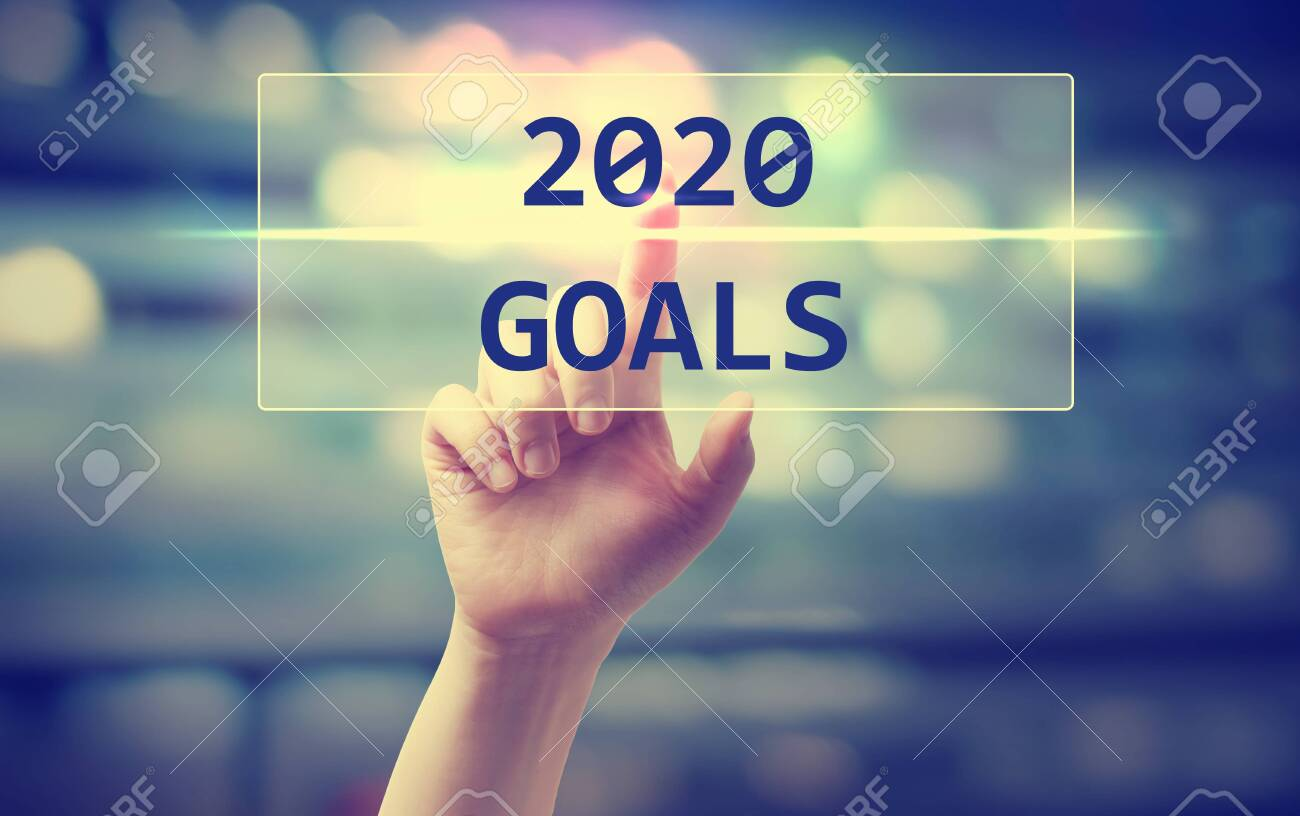 2020 Goals concept with hand pressing a button on blurred abstract - 133604965