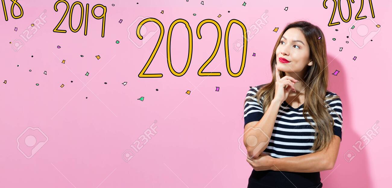 2020 with young woman in a thoughtful pose - 133541889
