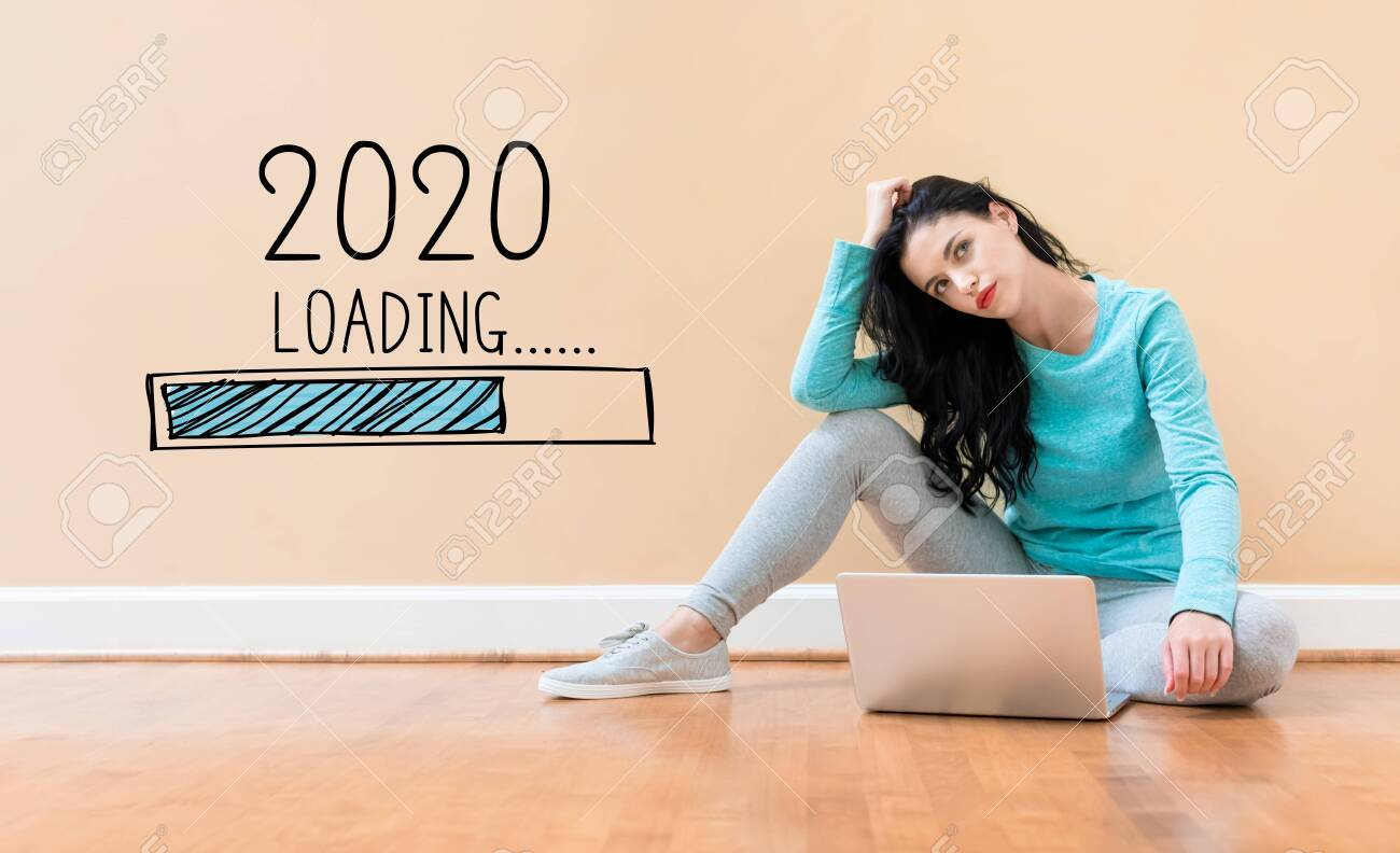 Loading new year 2020 with young woman using a laptop computer - 133756233