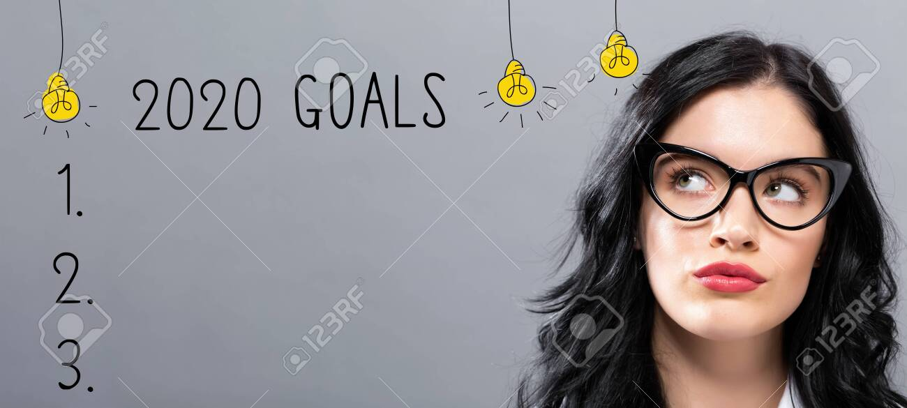 2020 goals with young businesswoman in a thoughtful face - 133804398