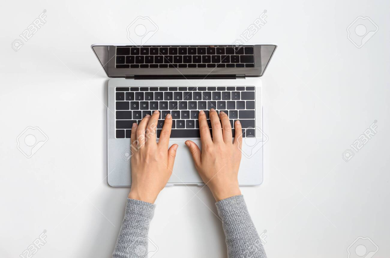 Person using a laptop computer at a work desk - 133804545