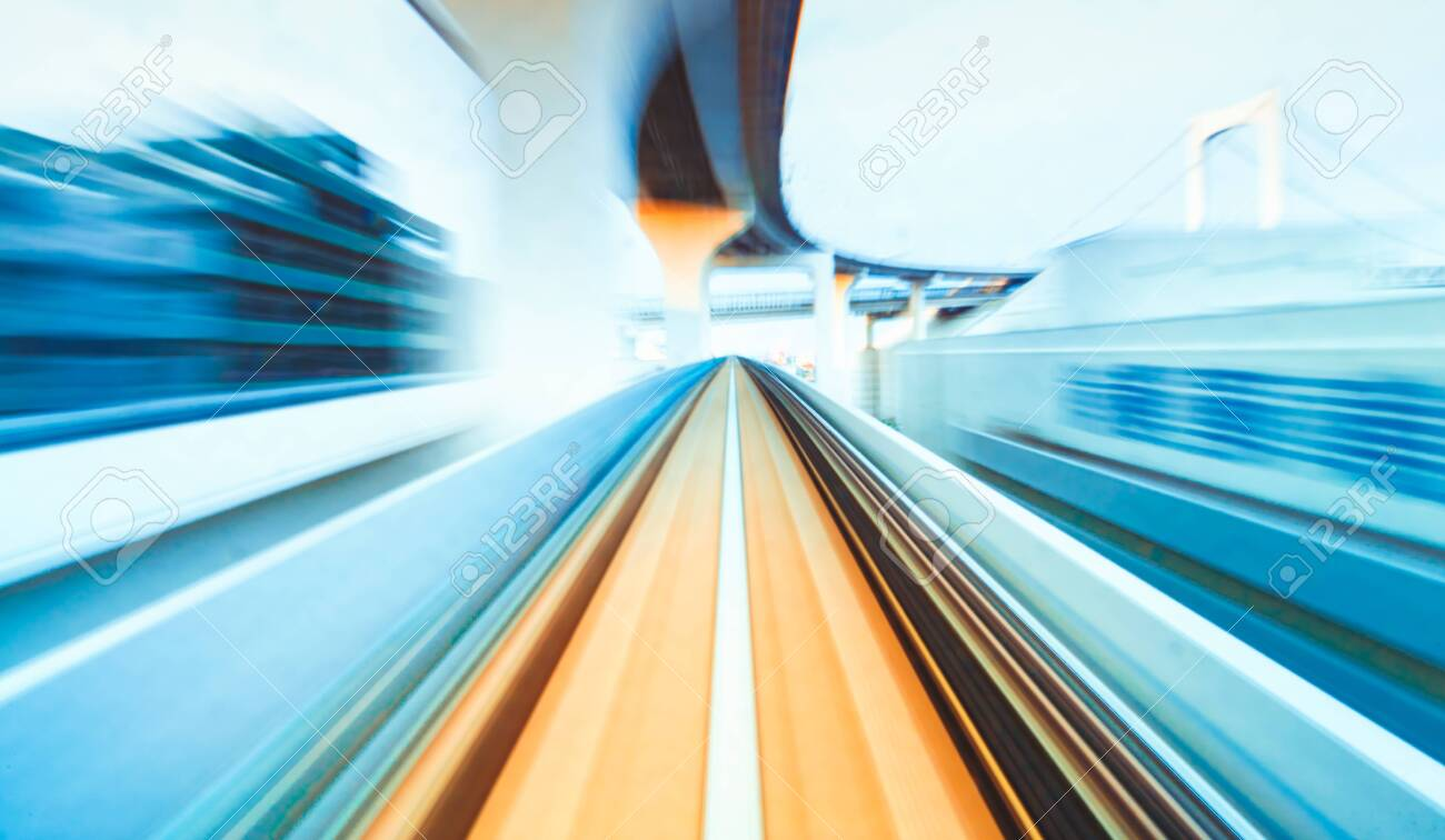 Abstract high speed technology POV train motion blurred concept from the Yuikamome monorail in Tokyo, Japan - 151796363