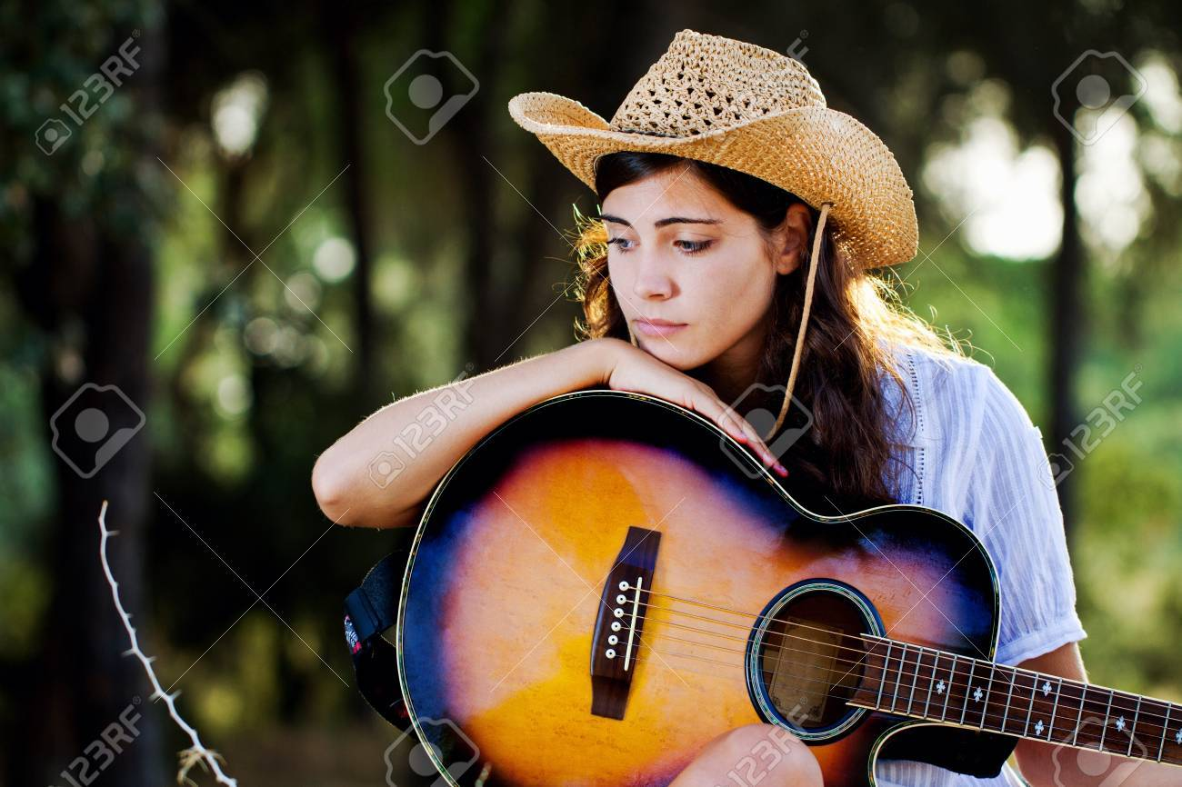 View Of A Beautiful Young Country Girl With A Guitar On The Woods Stock Photo Picture And Royalty Free Image Image 10488954