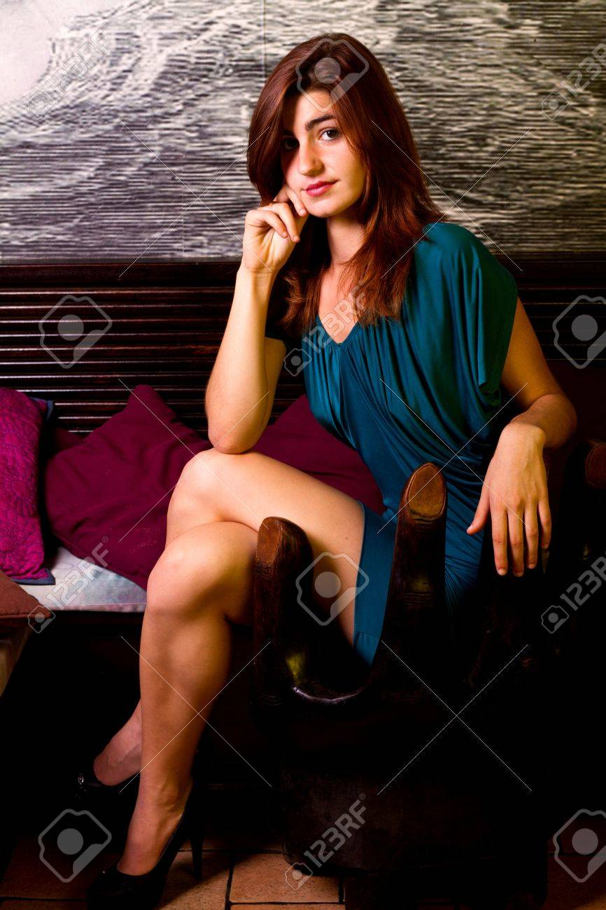 View of a beautiful young girl on a blue dress inside a bar pub. Stock Photo - 12211667