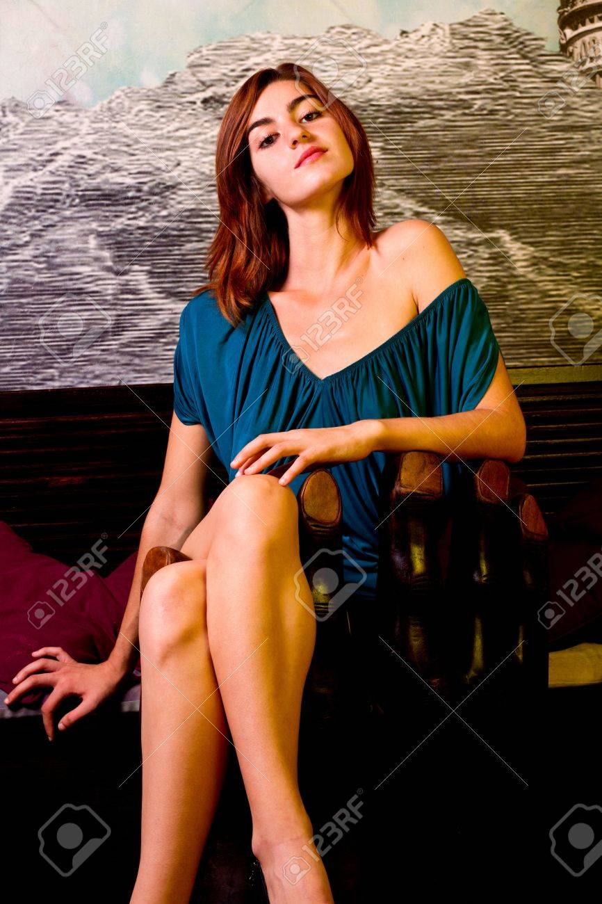 View of a beautiful young girl on a blue dress inside a bar pub. Stock Photo - 12212113