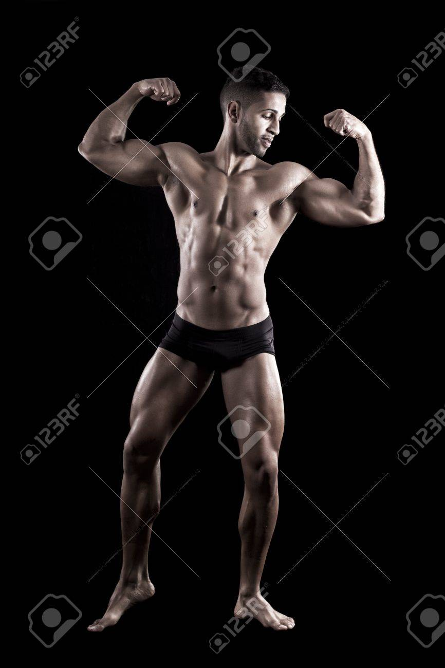 View of a muscled man on a black background in artistic, fitness and bodybuilding poses. Stock Photo - 17488476