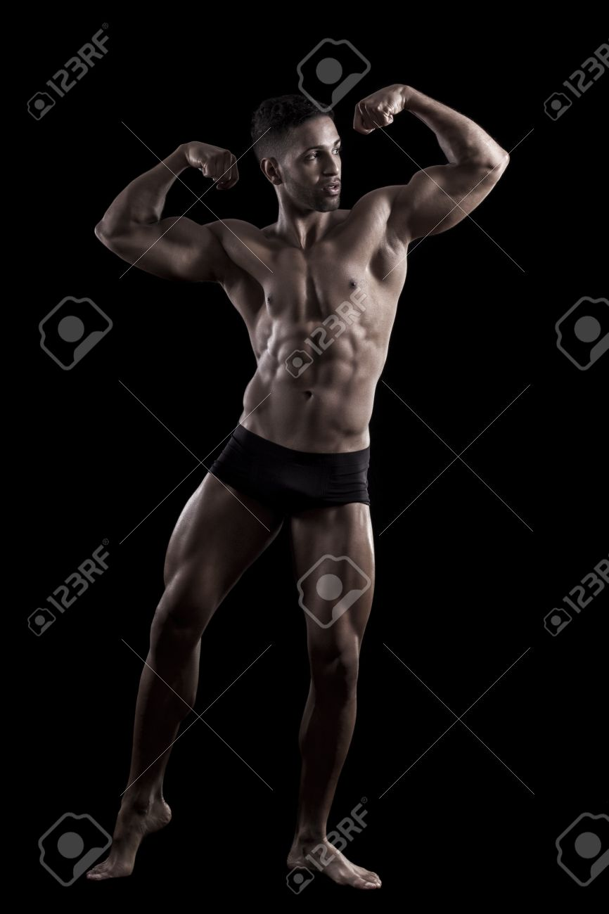 View of a muscled man on a black background in artistic, fitness and bodybuilding poses. Stock Photo - 17488389