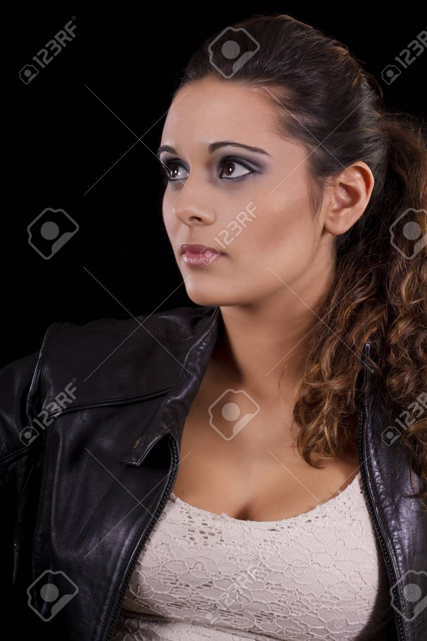 View of a beautiful young girl with a black leather jacket. Stock Photo - 17489232