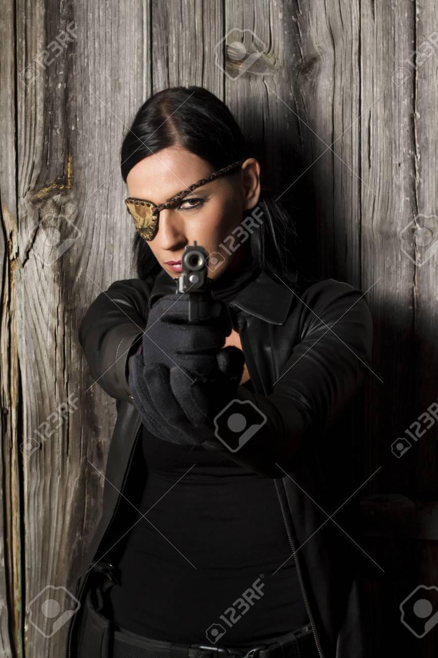 View of a beautiful action girl holding a weapon in a outdoor location. Stock Photo - 17489353