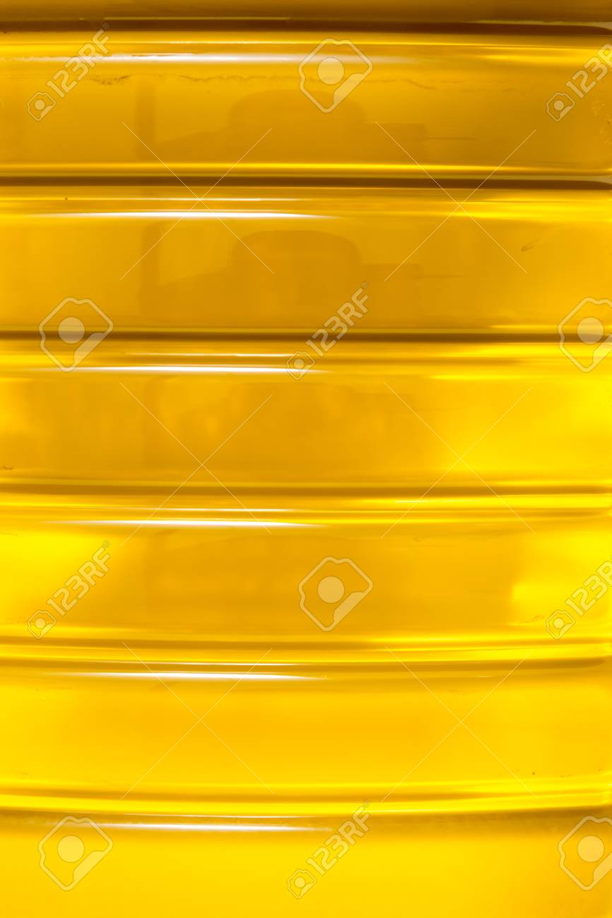8fd8e32aa6a8 Close up macro of a plastic bottle filled with olive oil. Stock Photo -  92821755