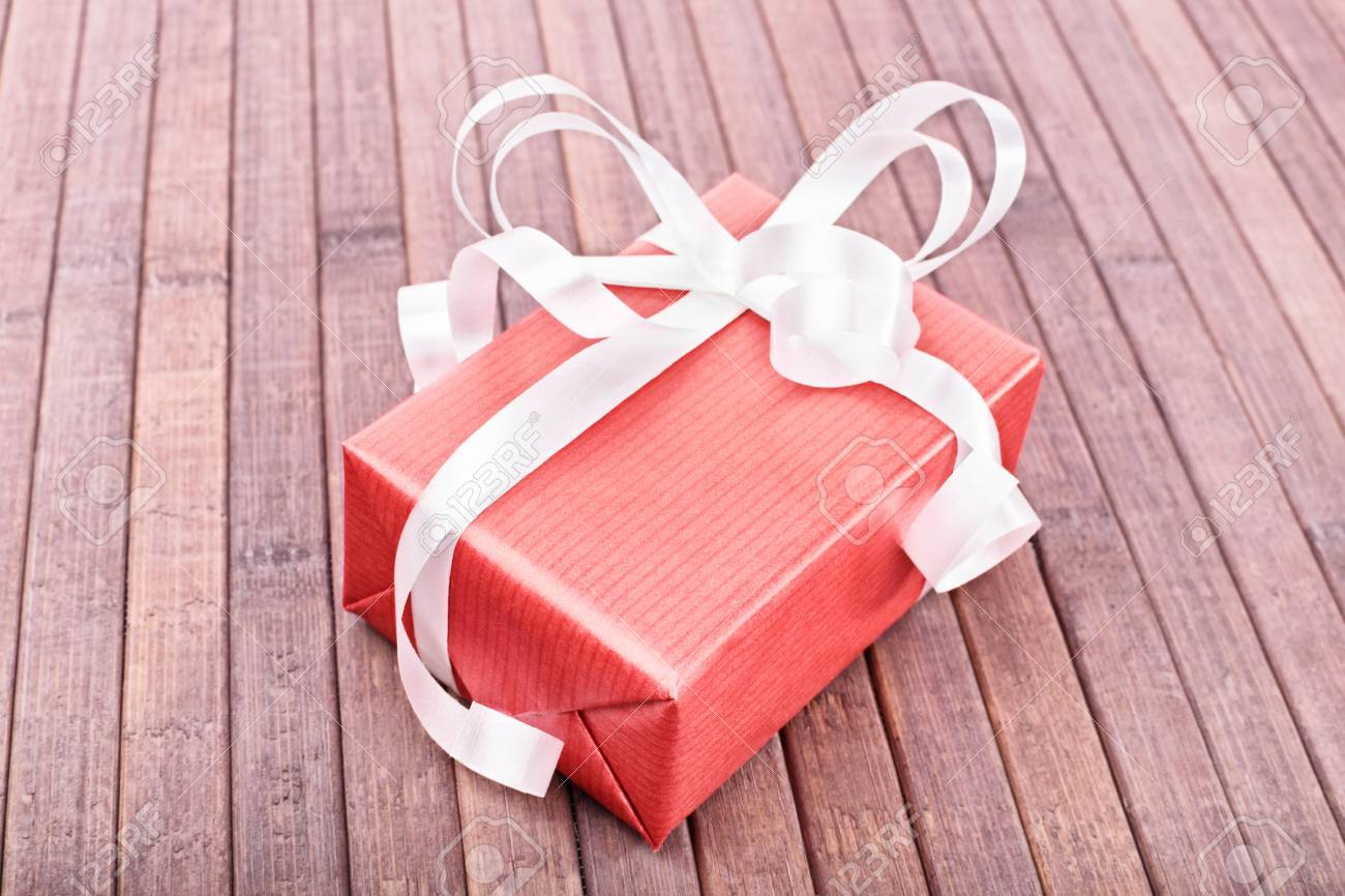 Close-up Shot Of A Small Gift Box On A Wooden Background Stock Photo ...
