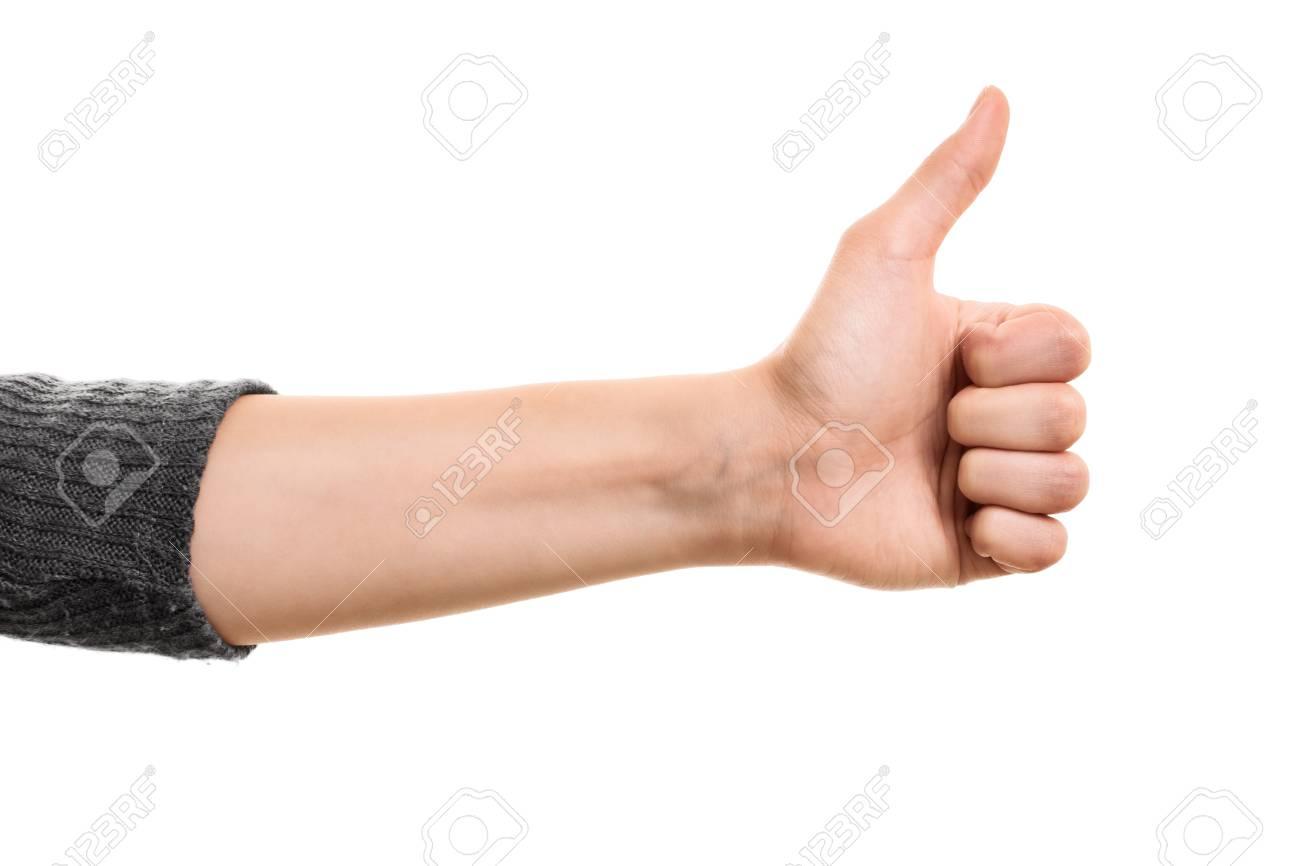 d9c9966617 Main Femme faisant un geste coup de pouce isolé sur fond blanc. Banque d'