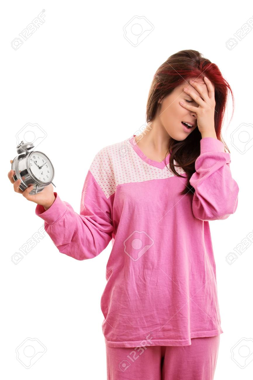 Portrait of a young girl, holding an alarm clock, panicking because