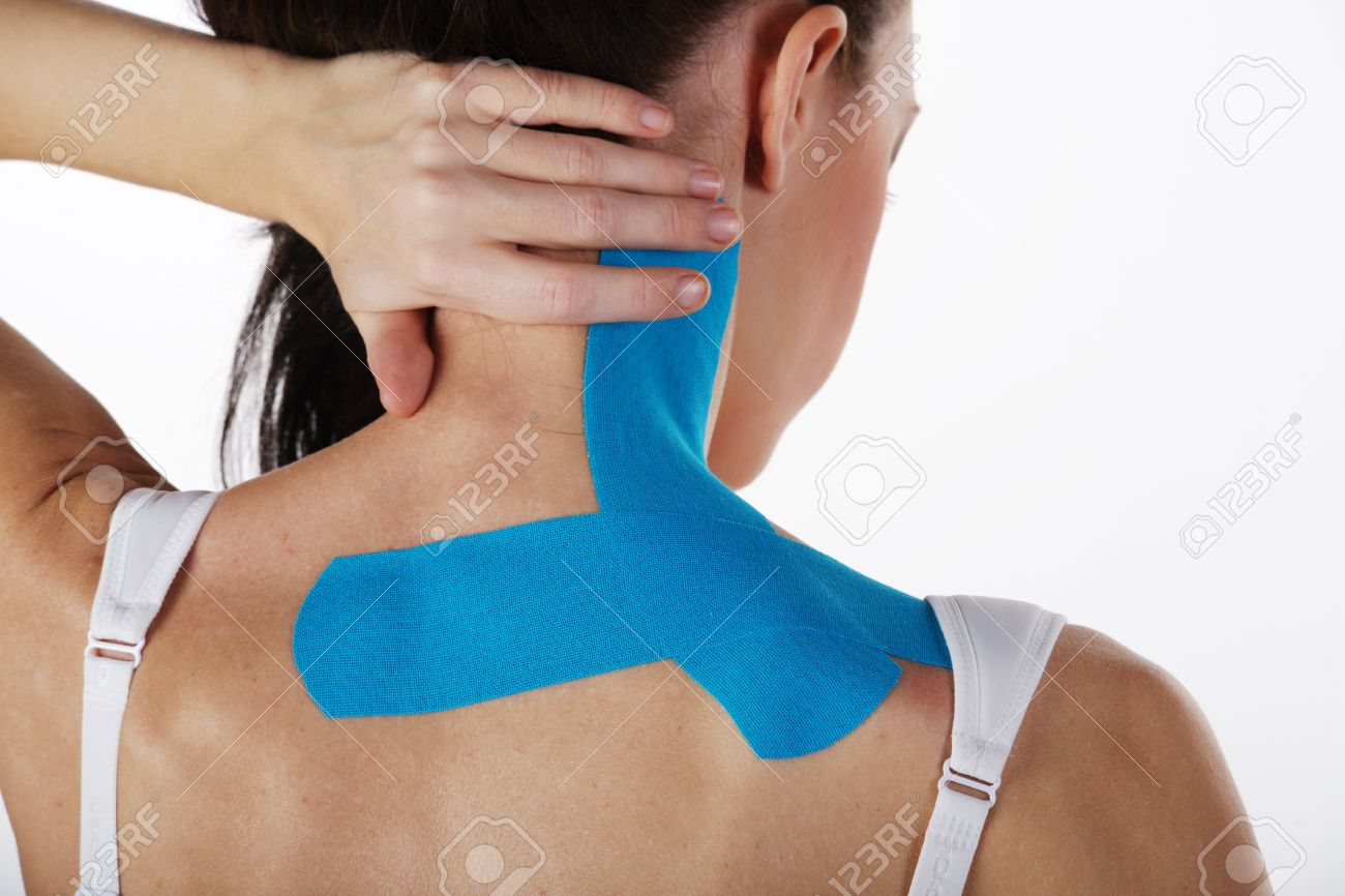 young pretty woman with sports taping on neck and shoulder Standard-Bild - 28589666