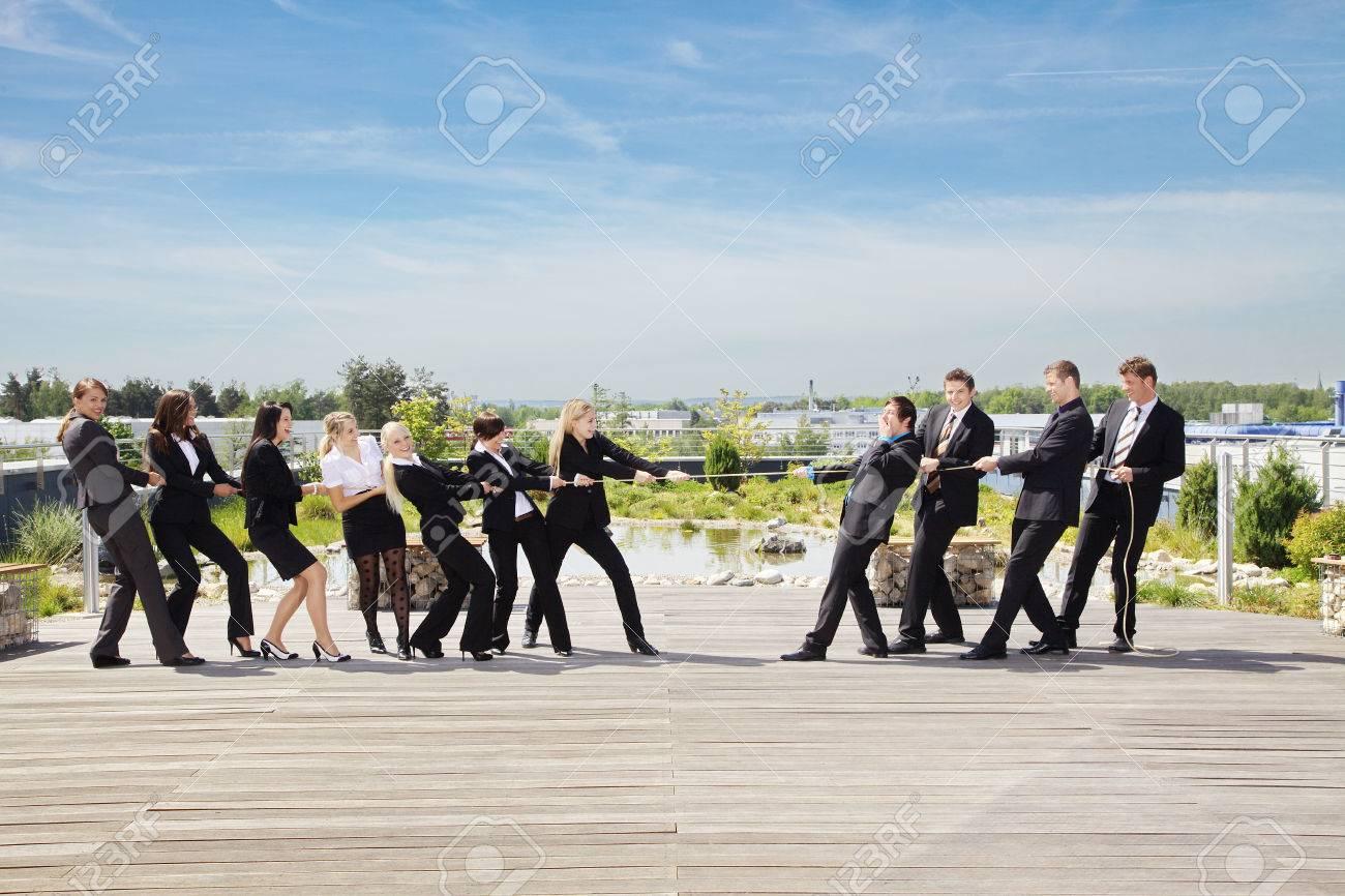 Business Teamwork People pulling on rope - 32052229