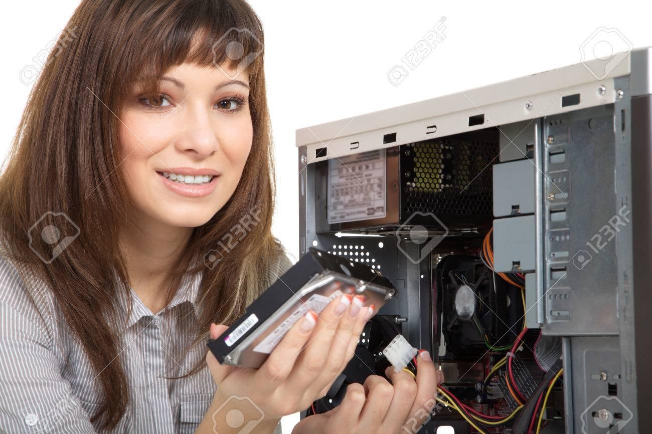 beautiful young woman repairing the computer - 28804168
