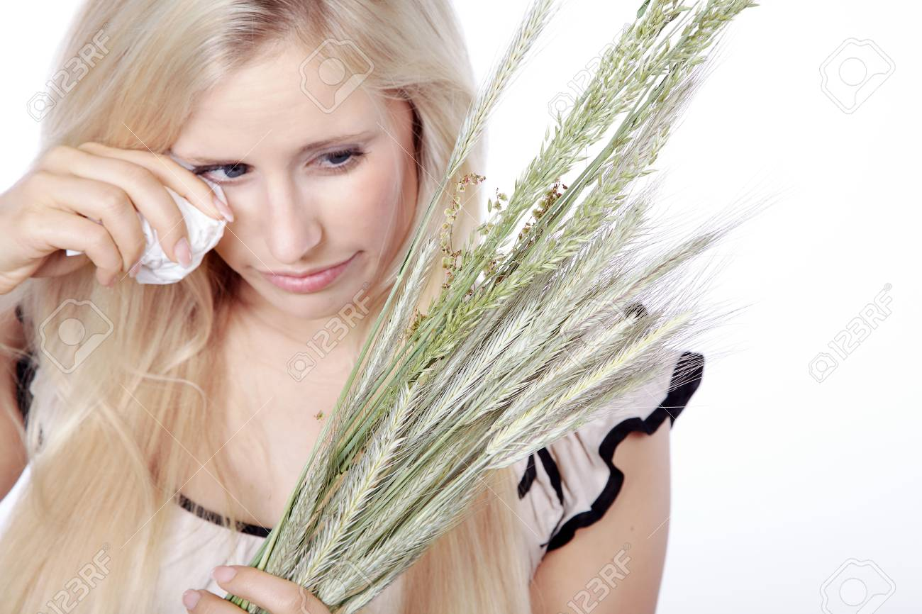 woman with handkerchief and grasses in hand - 28768698