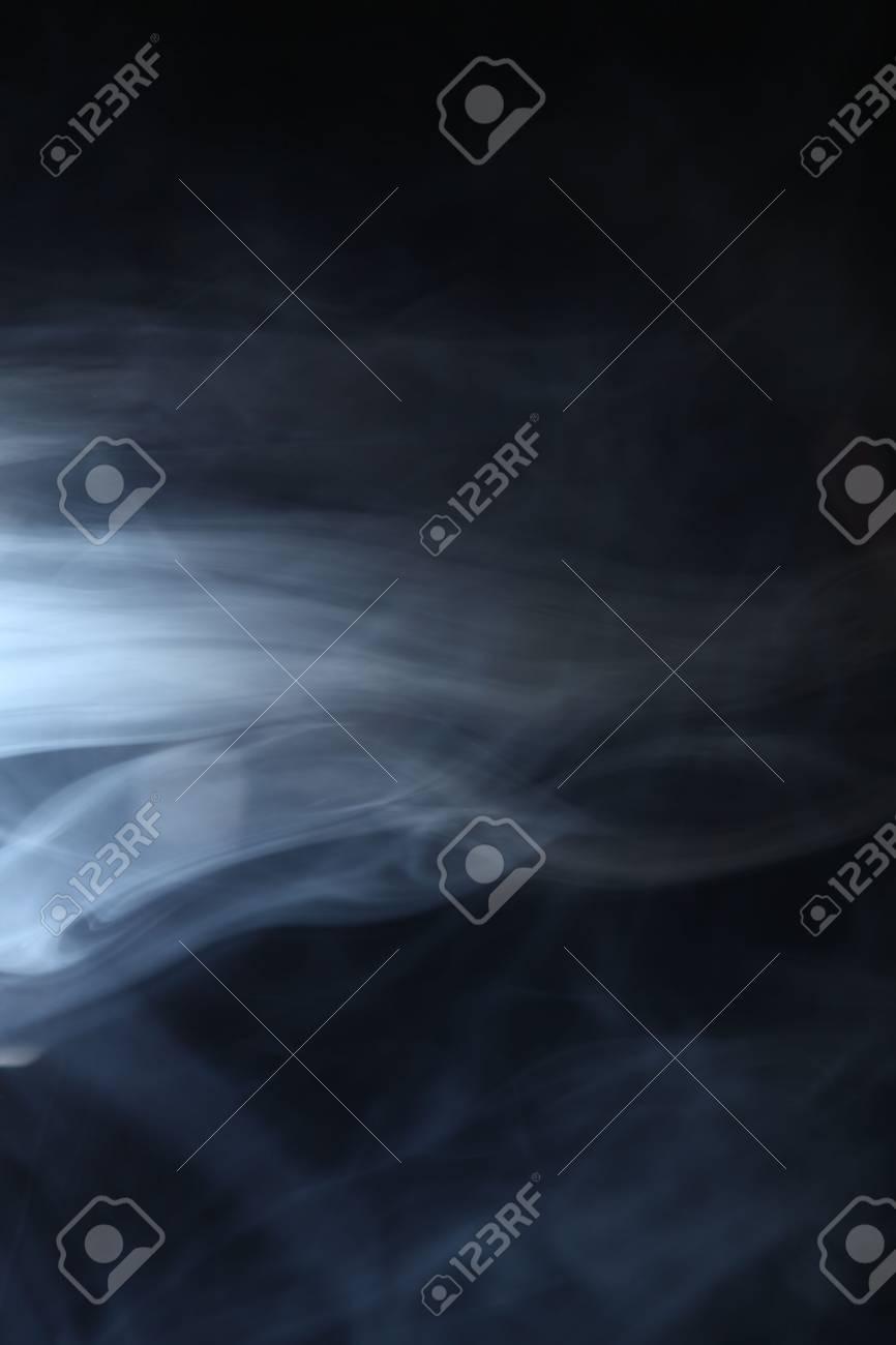 smoke in the light on a dark - 28738518