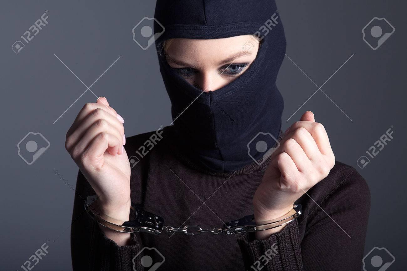 burglar with mask and handcuffs - 32091842
