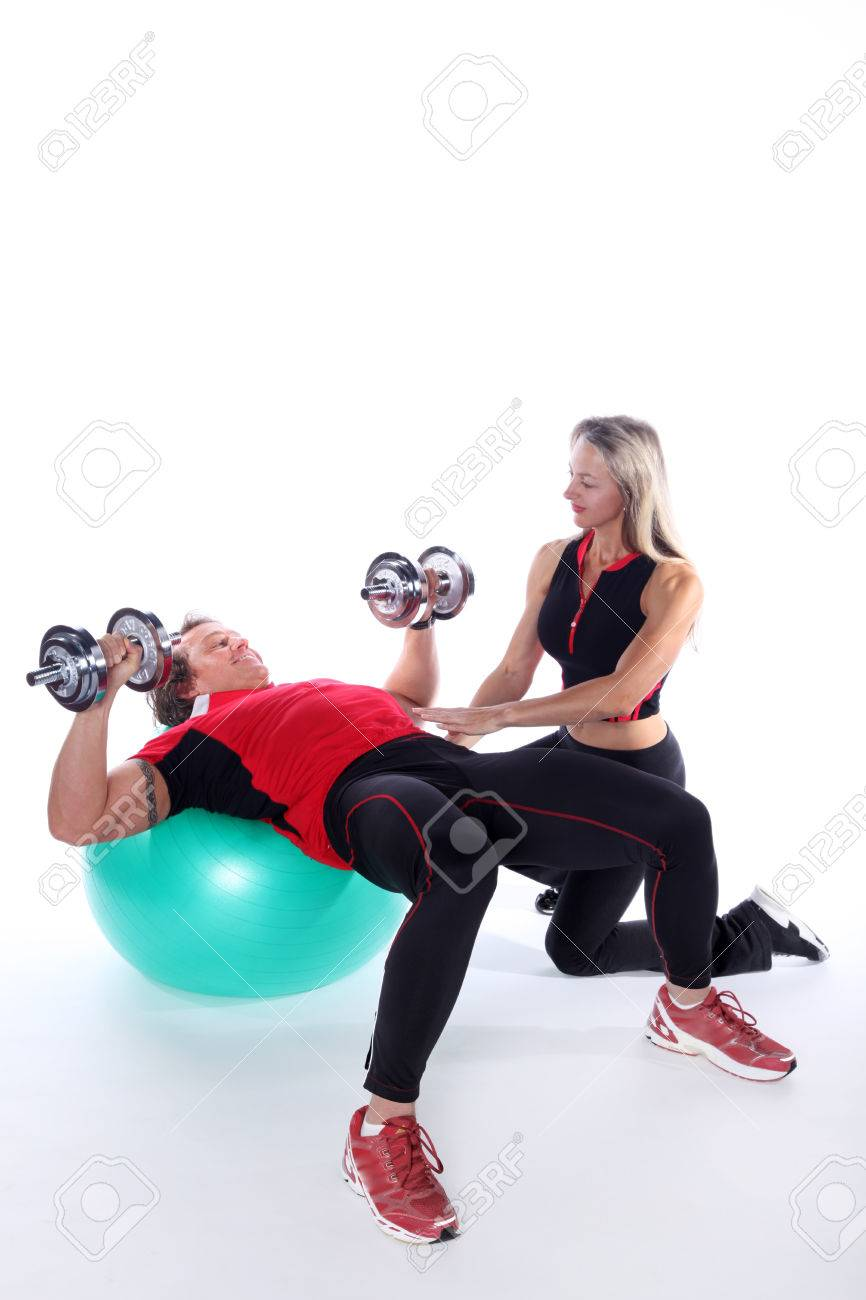 nice trainer couple in sports exercises - 32088341