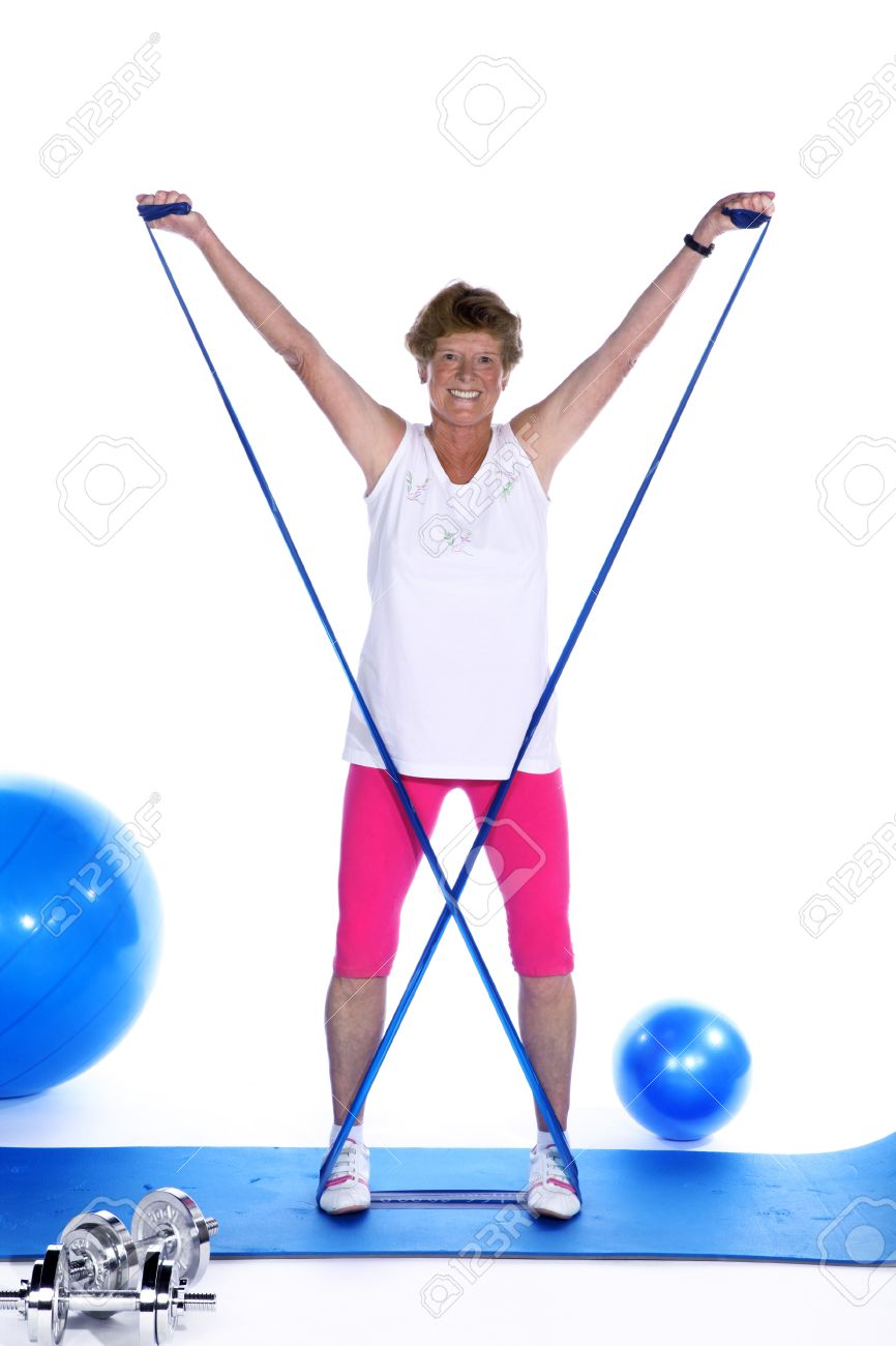 sporty mature woman with stretch band exercises - 32091875