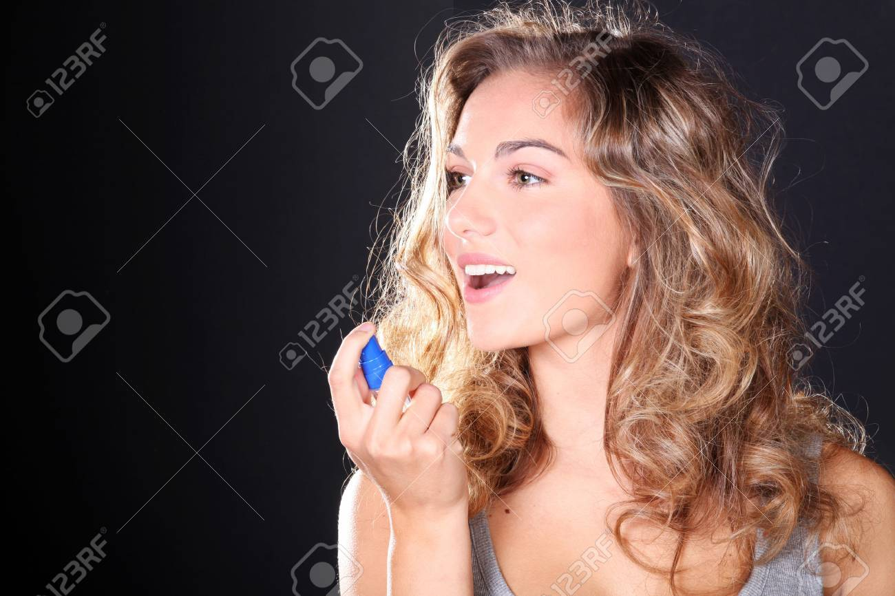 beautiful woman taking a breath spray Standard-Bild - 31805908