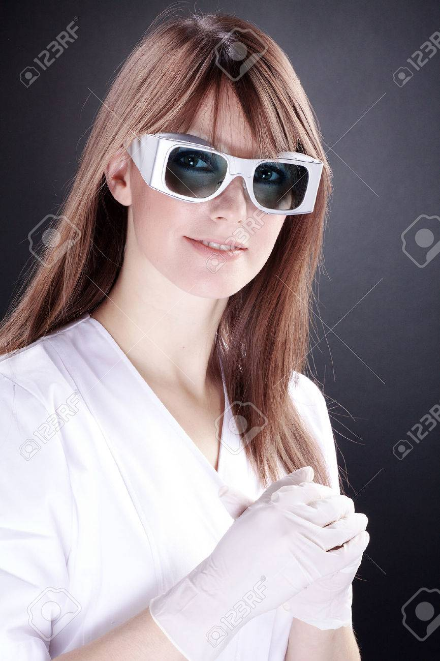 woman as a lab technician with laser safety goggles - 31658352