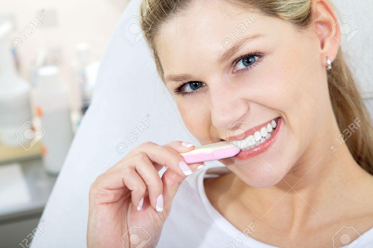 model with nice teeth eating sweets Standard-Bild - 31459108