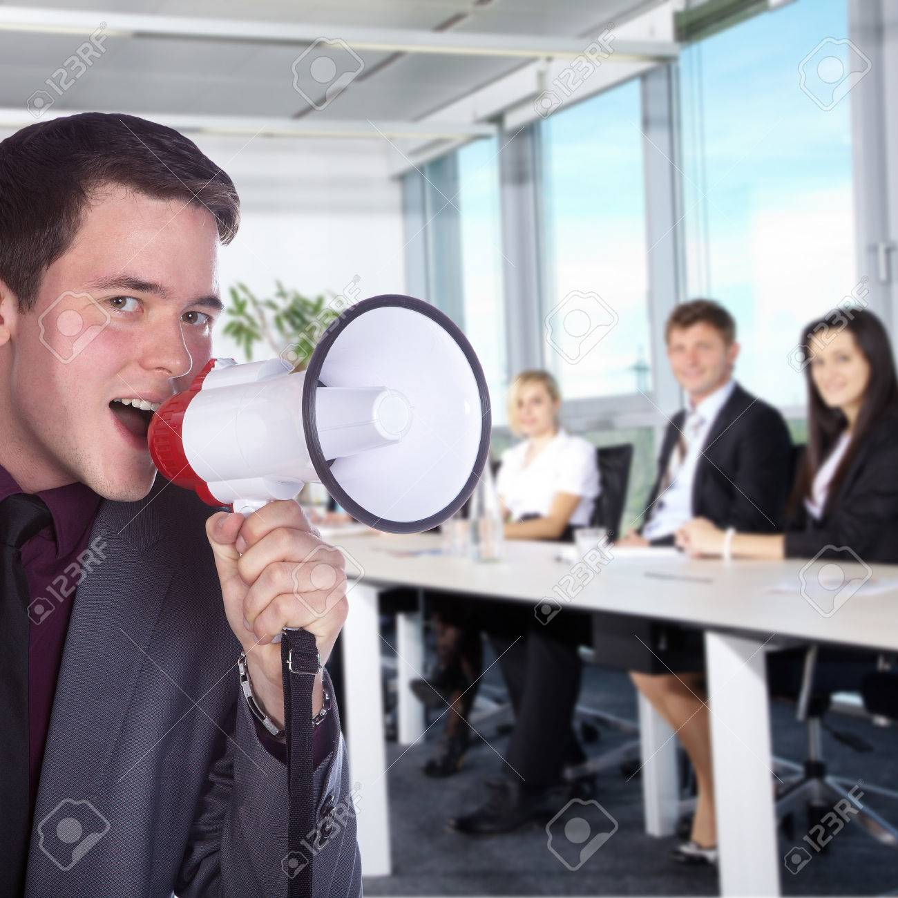 Business man with a megaphone in office - 32091880