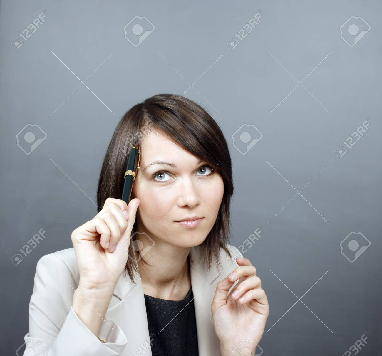 Businesswoman holding a pen Stock Photo - 17645366