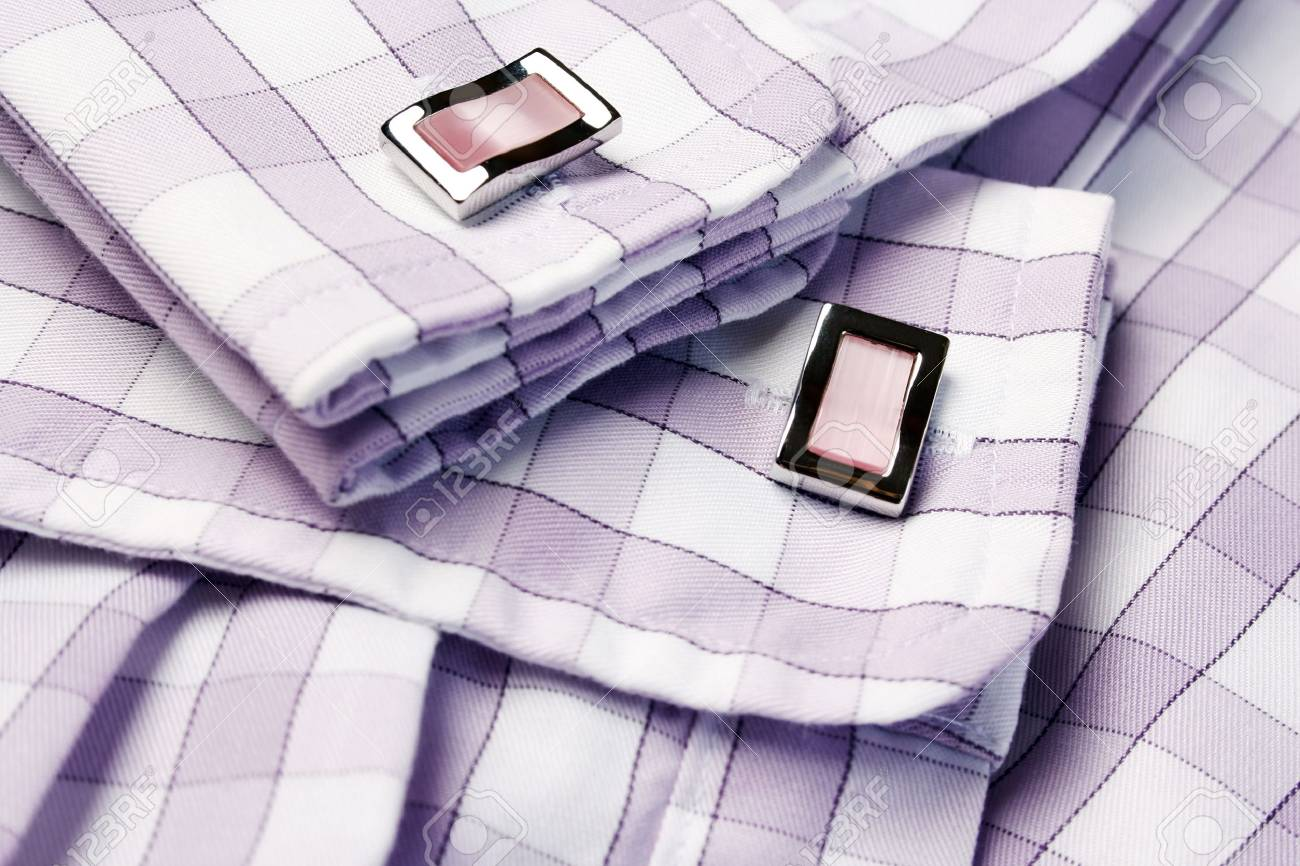 Close-up of cufflinks on men�s checkered shirt Stock Photo - 18128341