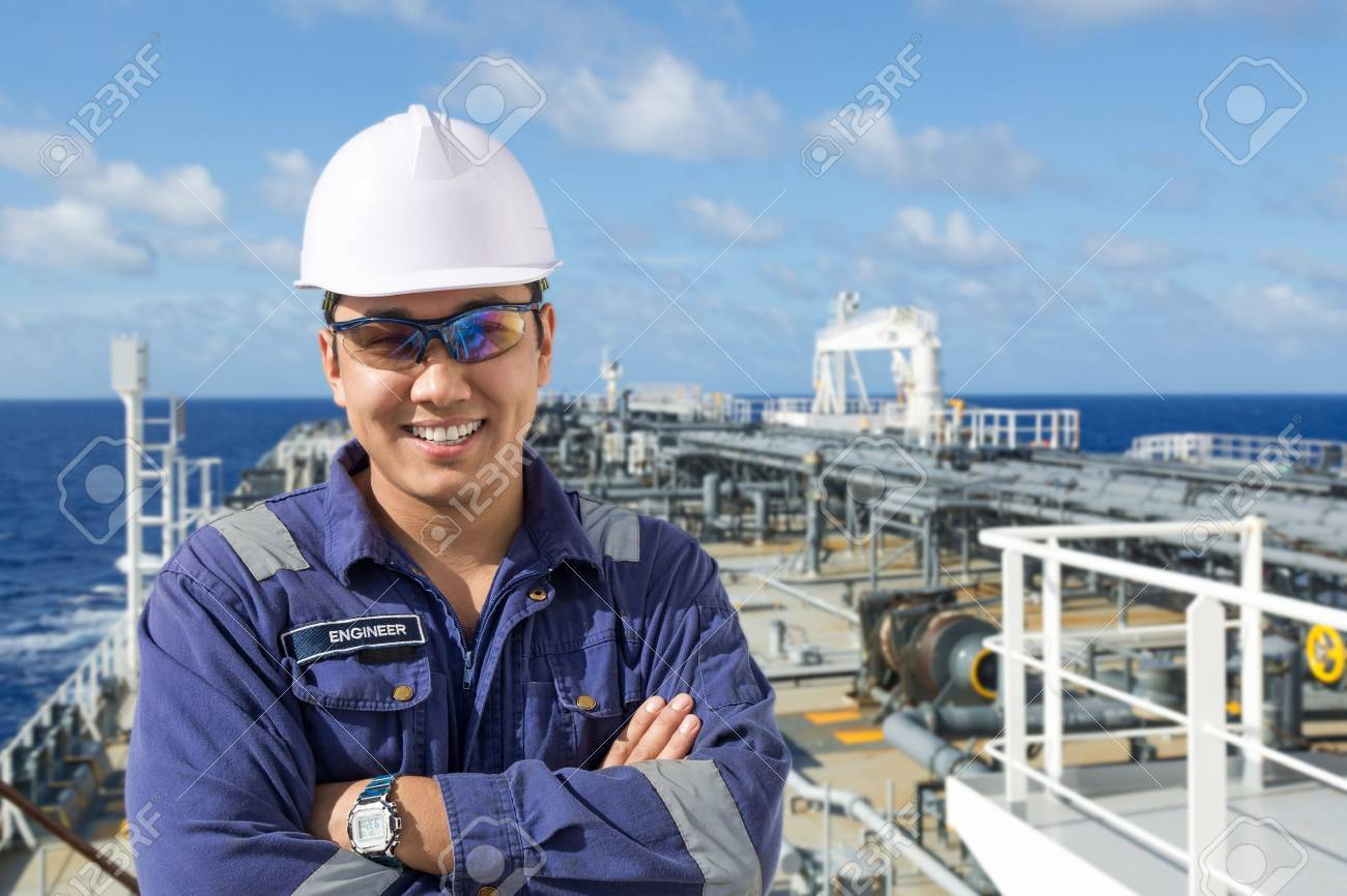 Portrait of asian engineer on the oil tanker deck. - 67607083