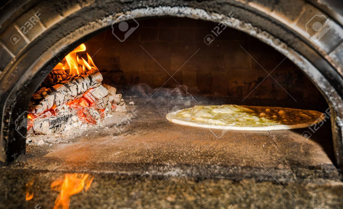 pizza dough in traditional italian wood fired stove - 58850265
