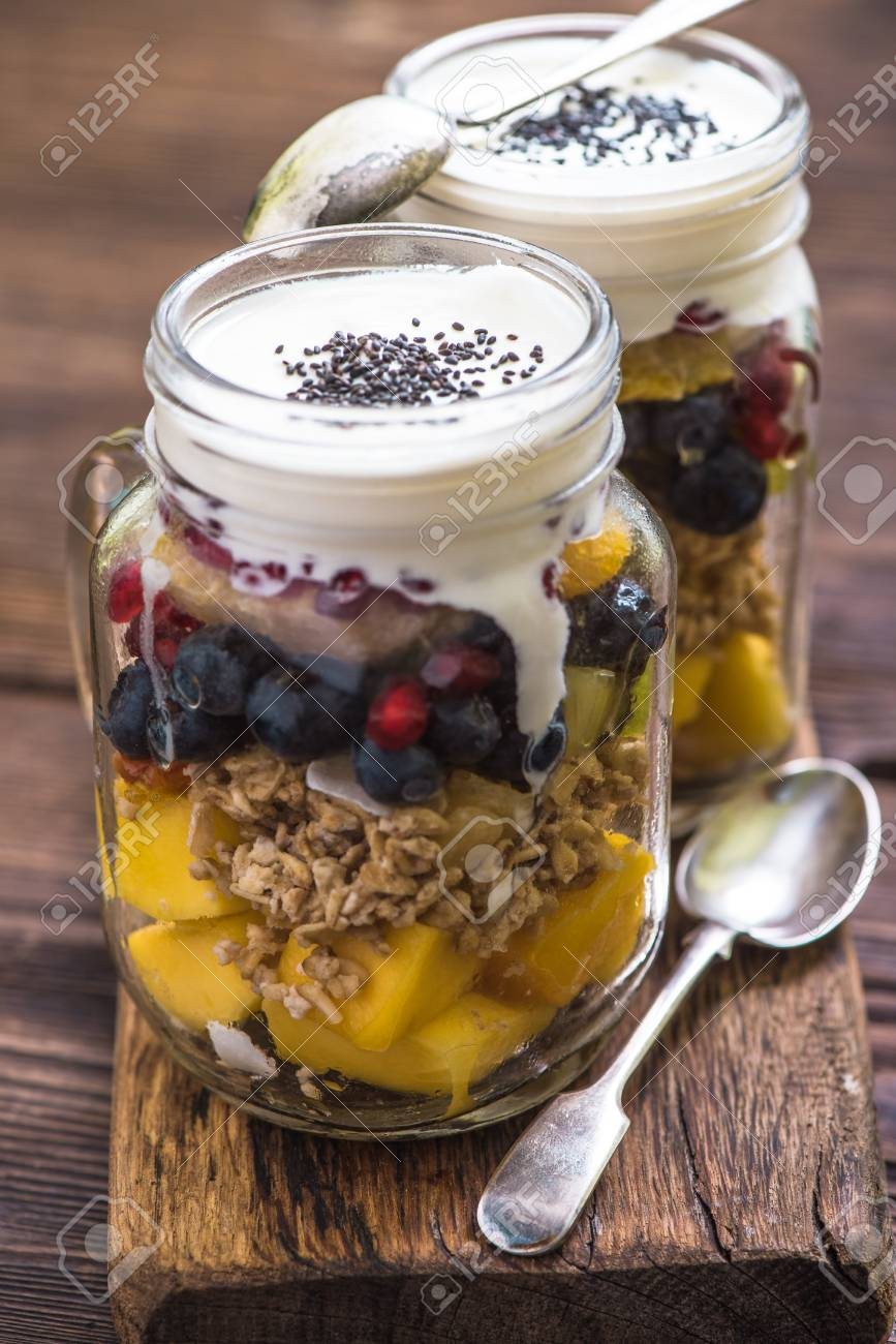 heathy breakfast fruity salad with chia and basil seeds served