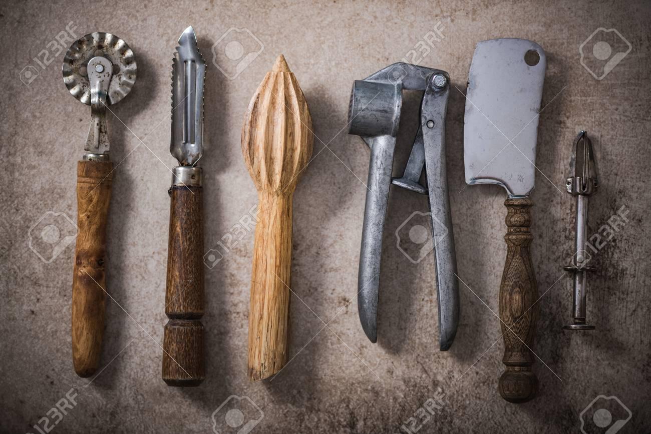 Vintage Kitchen Utensils On Stone Or Concrete Slate Stock Photo