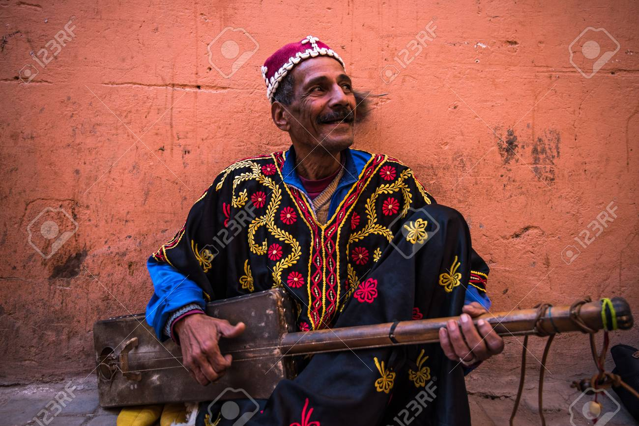 Marrakech,Morocco - January 2018:TStreet musician in traditional clothing performing on street - 95618536