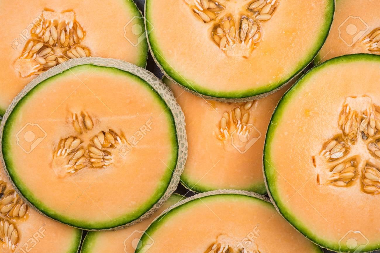 Cantaloupe melon slices, full frame food background. - 100351434