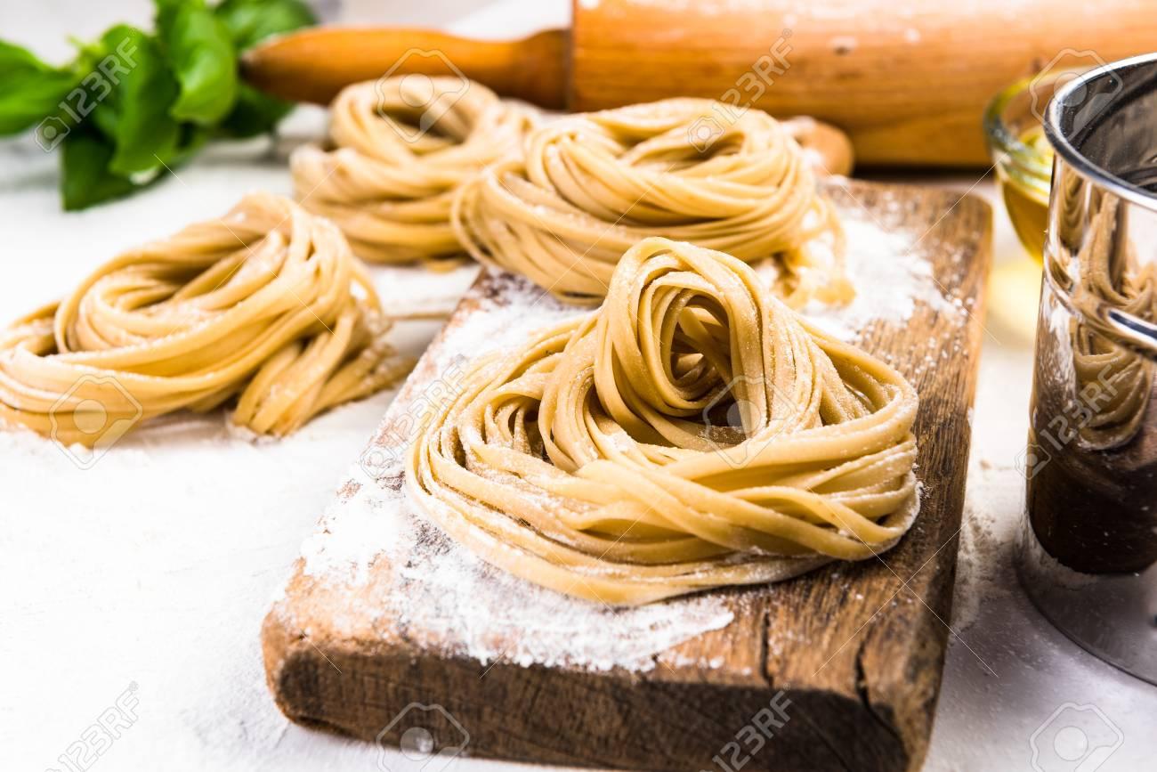 Making healthy italian pasta at home. - 125048933