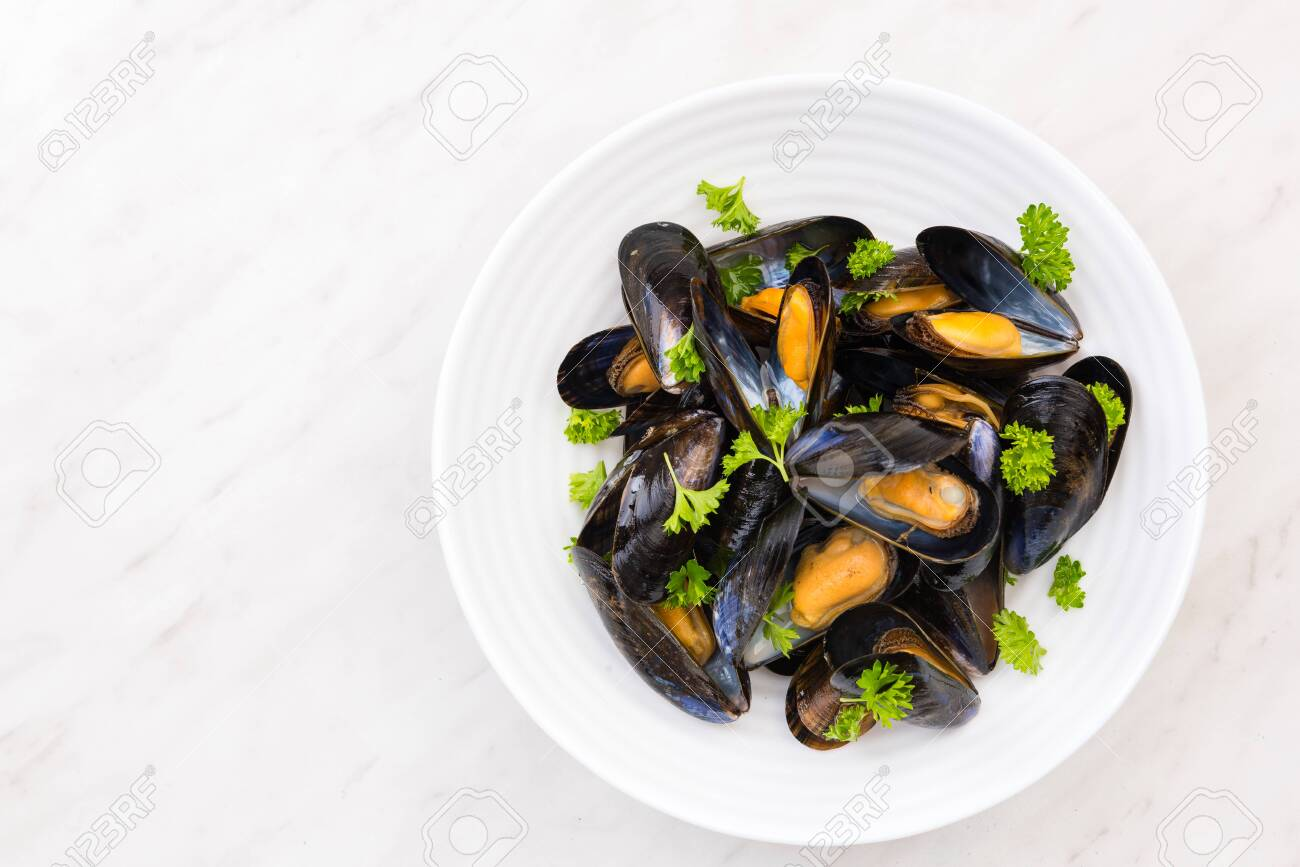 Freshly Catch Mussels Served on Plate,Seafood Restaurant Dish. - 127930665