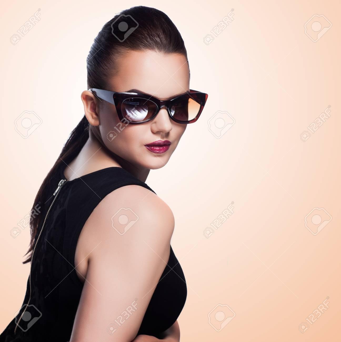 close-up portrait of beautiful and fashion girl in sunglasses, studio shot Stock Photo - 20667938