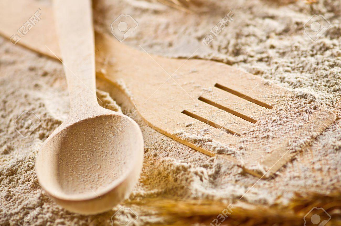 Spoon and scapula on flour background Stock Photo - 16573264