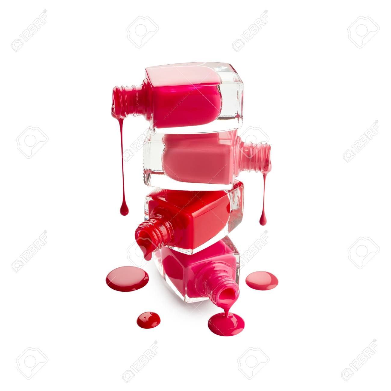 Stack Of Bottles With Spilled Nail Polish Isolated On White ...