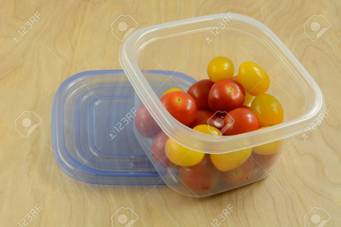 Red And Yellow Variety Cherry Tomatoes In Refrigerator Plastic