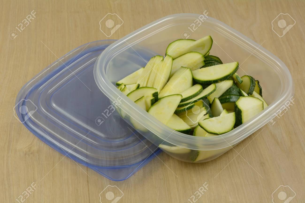 Raw Zucchini Slices In Plastic Refrigerator Storage Containers