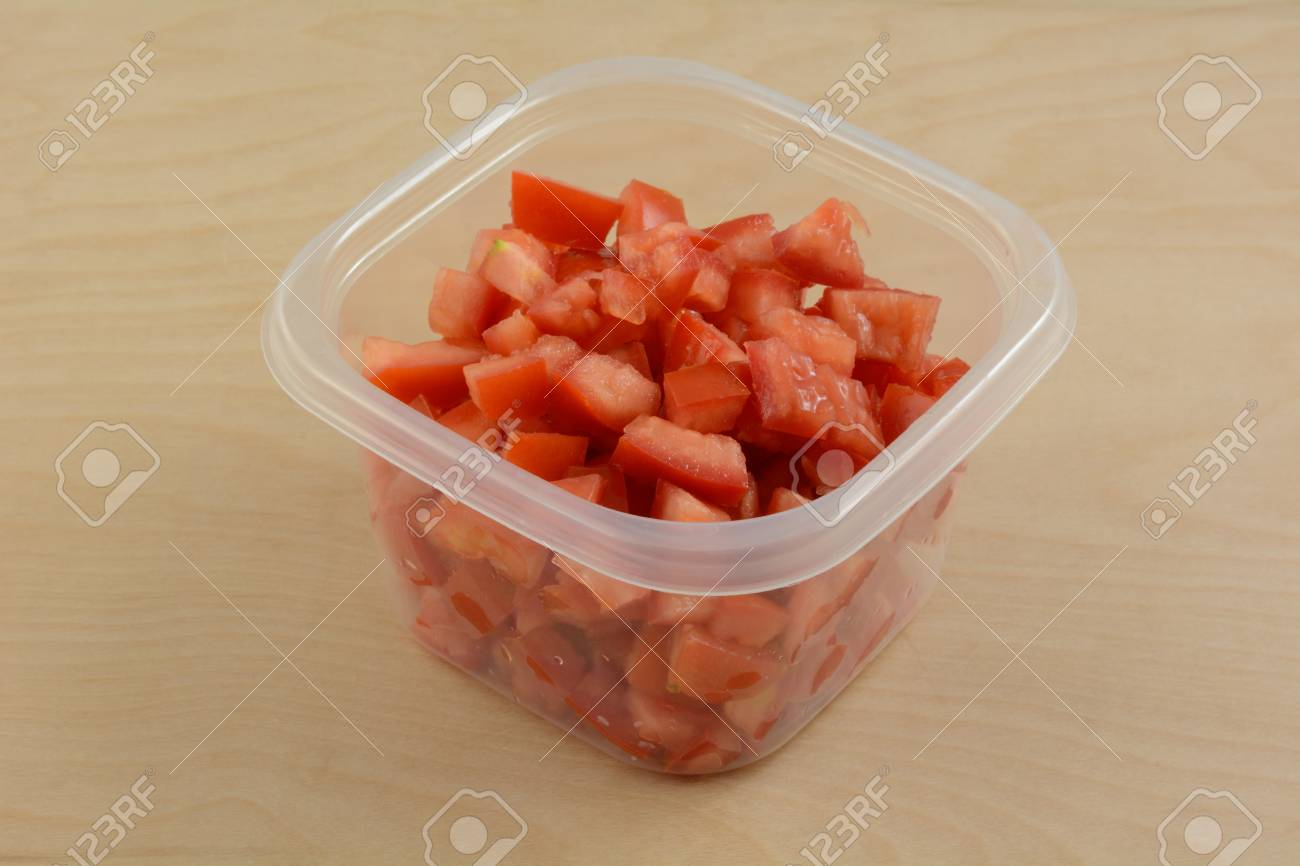 Chopped Roma Tomatoes In Plastic Storage Container In Preparation