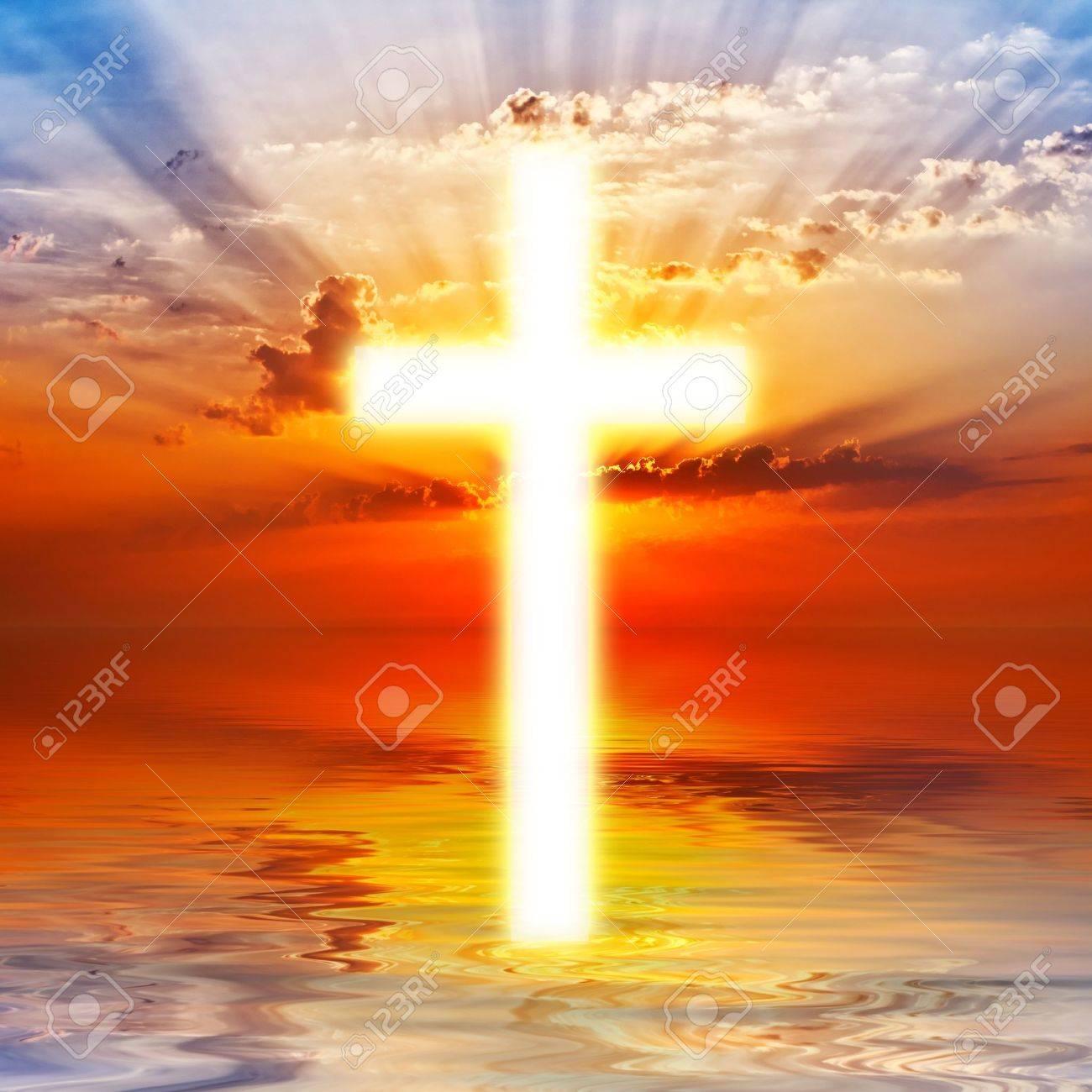 Cross appearing on sunrise sky - 16624115
