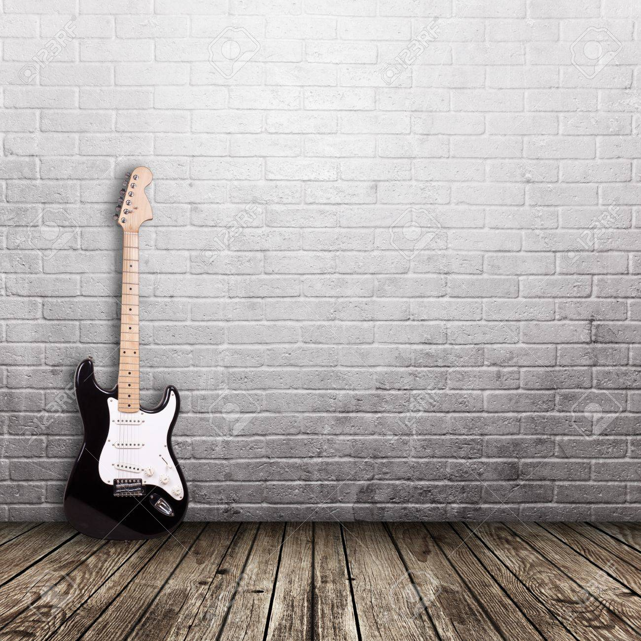Electric Guitar In The Room With Brick Wall Background Stock Photo Picture And Royalty Free Image Image 47347834